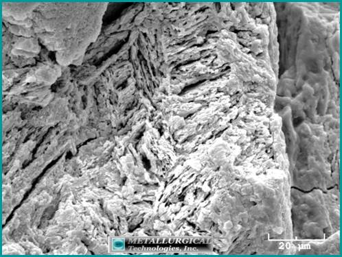 Preferential attack of the material microstructure through a combination of erosion and corrosion