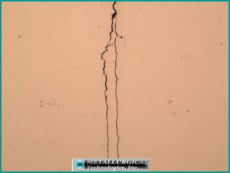 crack appeared to transition from a SCC mode to a straight crack path, more characteristic of fatigue propagation.