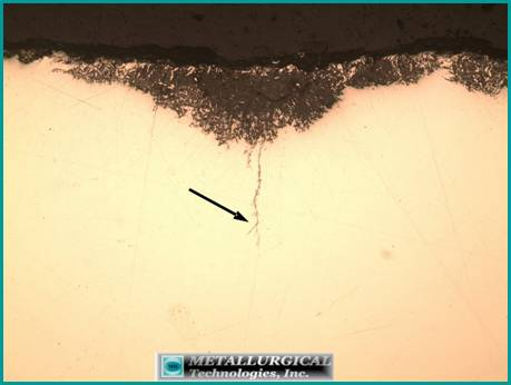 initial stages of cracking at the bottom of a shallow corrosion pit adjacent to the main fracture. Branching of the SCC crack