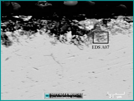 This back-scattered image shows one of the corrosion pits within the fracture initiation area.
