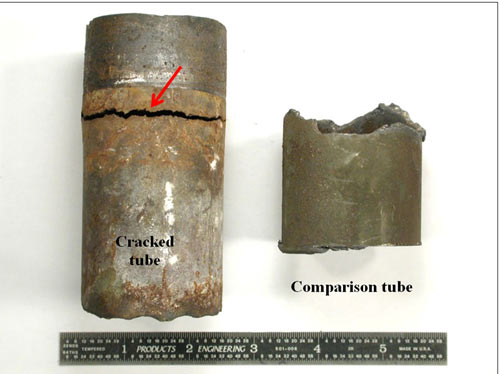 Overview of the cracked and comparison as-received preheater tubes. The arrow points to the circumferential crack near the tubesheet interface.