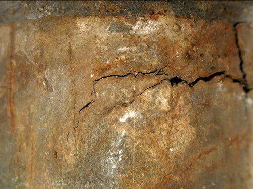 Close-up view of the crack tip showing an extensive crack network. The OD was covered with a refractory insulation at this location.