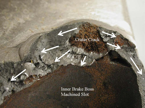 A closer view of the crater crack identified in Figure 2. The crack surface had a heavy rust deposit present prior to ultrasonic cleaning. Weld joint fracture originated from the crater crack